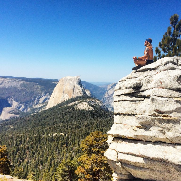 Tim Olson meditating in the mountains.