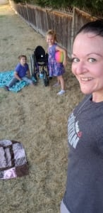 Savannah Lacy on a beach with her kids sharing that she hit her goal of 4200 burpees