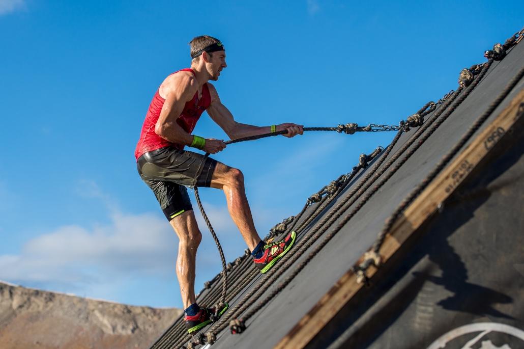 Spartan ultra challenger Jon Albon climbing a wall.