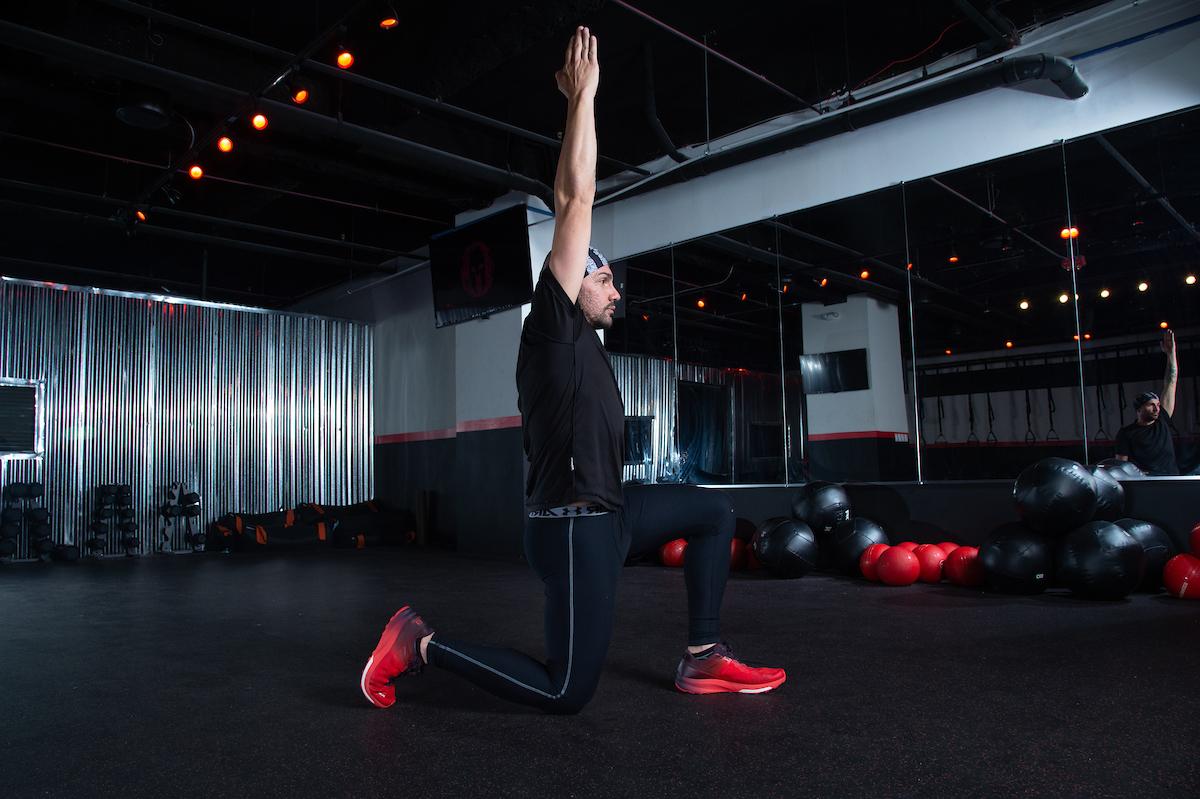 Half-kneeling hip flexor stretch upper body strength exercises