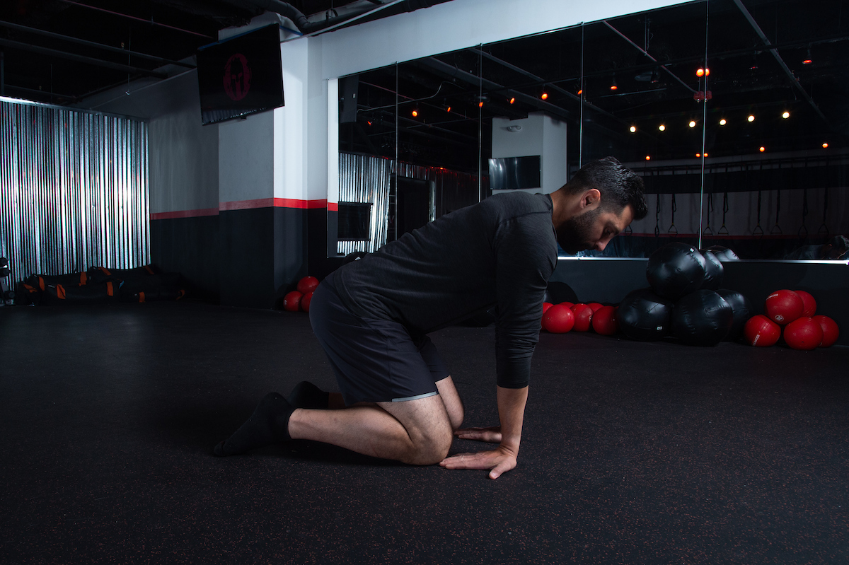 Quadruped wrist rock upper body strength exercises