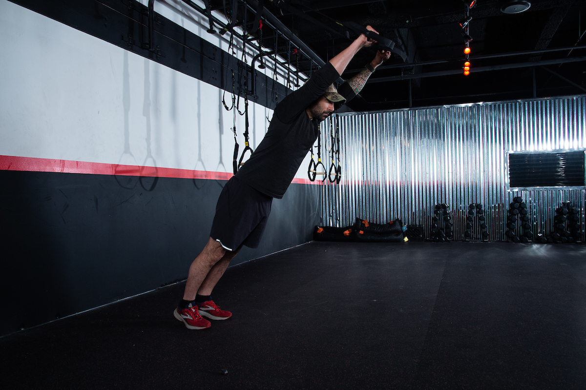 Suspension ab rollout upper body strength exercises