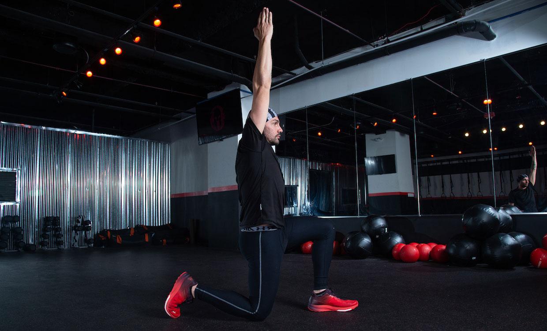 Half-kneeling hip flexor stretch upper body and core workout